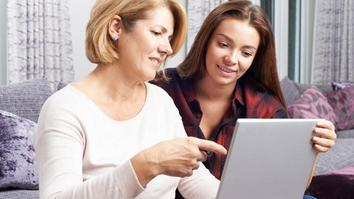 Mother and daughter looking at a laptop